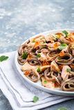Salmon and soba salad with caviar Stock Photos