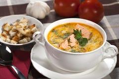 Salmon soup. Creamy salmon soup with croutons stock image