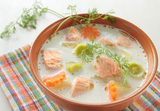 Salmon soup with cream, potatoes, carrots, dill Stock Photography