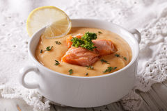 Salmon soup with lemon closeup on the table. horizontal Royalty Free Stock Images
