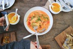 Salmon soup or stir fried salmon with tomato or salmon pasta. Dish stock images