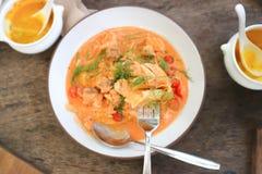 Salmon soup or stir fried salmon with tomato. Or salmon pasta dish royalty free stock photo