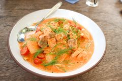 Salmon soup or stir fried salmon with tomato. Or tomato soup royalty free stock photography