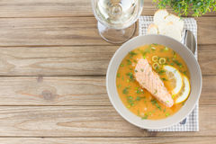 Salmon soup on wooden desk background Stock Image