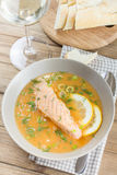 Salmon soup on wooden desk background Stock Images