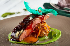 Salmon sous vide with julienne of stewed vegetables Royalty Free Stock Photos