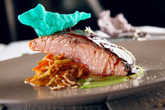 Salmon sous vide with julienne of stewed vegetables Royalty Free Stock Photography