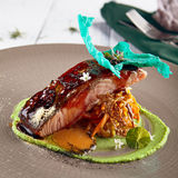 Salmon sous vide with julienne of stewed vegetables Royalty Free Stock Image