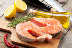 Salmon, spices and condiments Stock Photos