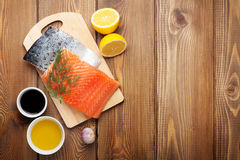 Salmon, spices and condiments Royalty Free Stock Image