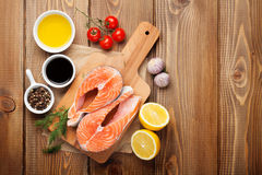 Salmon, spices and condiments Royalty Free Stock Photos