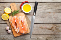 Salmon, spices and condiments Stock Photography