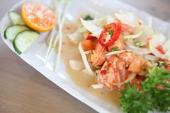 Salmon spicy salad. In close up stock photography