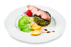 Salmon with spinach garnish Stock Photo