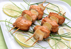 Salmon and spring onion skewers Stock Photo