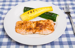 Salmon with Squash on White Plate Stock Photo