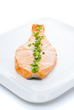 Salmon stake with green onion on white plate isolated Stock Images