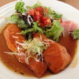 Salmon stake. A healthy dish with Salmon stake on top by Stock Image