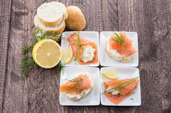 Salmon starters on small plates Royalty Free Stock Photo