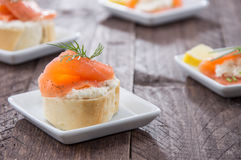Salmon starters on small plates Stock Photos