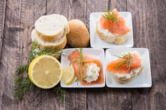Salmon starters on small plates Royalty Free Stock Photos