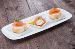 Salmon starters on small plates Royalty Free Stock Images