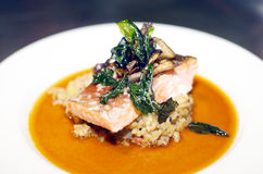 Salmon Steak. Seafood main course meal of Salmon Steak on bed of rice Royalty Free Stock Photo