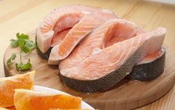 Salmon steak. On a round board Royalty Free Stock Images