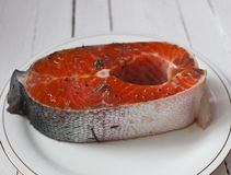 Salmon steak. With seasoning and herbs Royalty Free Stock Photography