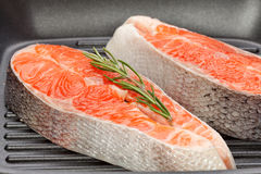 Salmon steak. On frying pans background Stock Photography