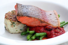 Salmon steak. Fresh atlantic salmon steak on a bed of beans and mash Stock Images