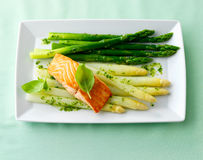 Salmon steak with asparagus Stock Photo