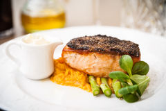 Salmon steak with asparagus Royalty Free Stock Image