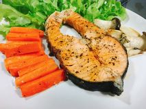 Salmon steak with black pepper. And fresh carrot, mushroom Royalty Free Stock Photography