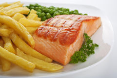 Salmon Steak with Chips and Peas Stock Photo
