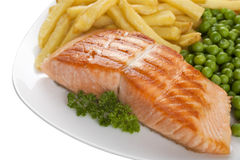 Salmon Steak with Chips and Peas Royalty Free Stock Photography
