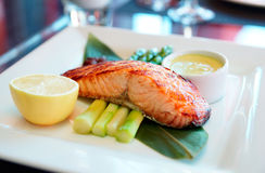 Salmon steak cooked in asian style. On restaurant table Stock Photography