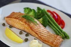 Salmon steak and cookeg vegetables Royalty Free Stock Image