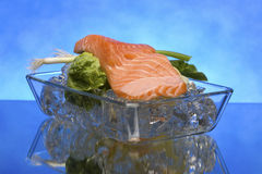 Salmon steak on crystal ice cubes Royalty Free Stock Image