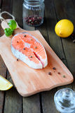 Salmon steak on a cutting board Royalty Free Stock Photos