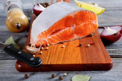Salmon steak on a cutting board. Cooking concept Stock Image