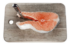 Salmon steak on cutting board Stock Photo