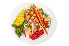 Salmon Steak Dinner. Overhead view of a grilled salmon steak with vegetables corn and asparagus Royalty Free Stock Photo