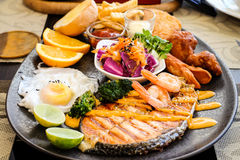 Salmon steak with egg and salad Stock Photography