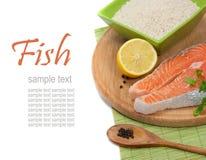 Salmon steak filet. Fresh salmon steak filet, uncooked rice, ginger, lemon. Over white with sample text Stock Photos
