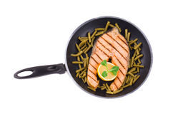 Salmon steak with french beans. Royalty Free Stock Image