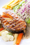 Salmon Steak with French fries Stock Images