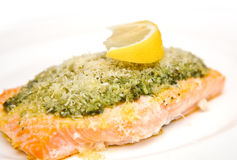 Salmon steak with fresh basil pesto Royalty Free Stock Image