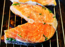 Salmon steak fried on grill. Stock Photo