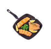 Salmon steak in the fry pan Royalty Free Stock Photo